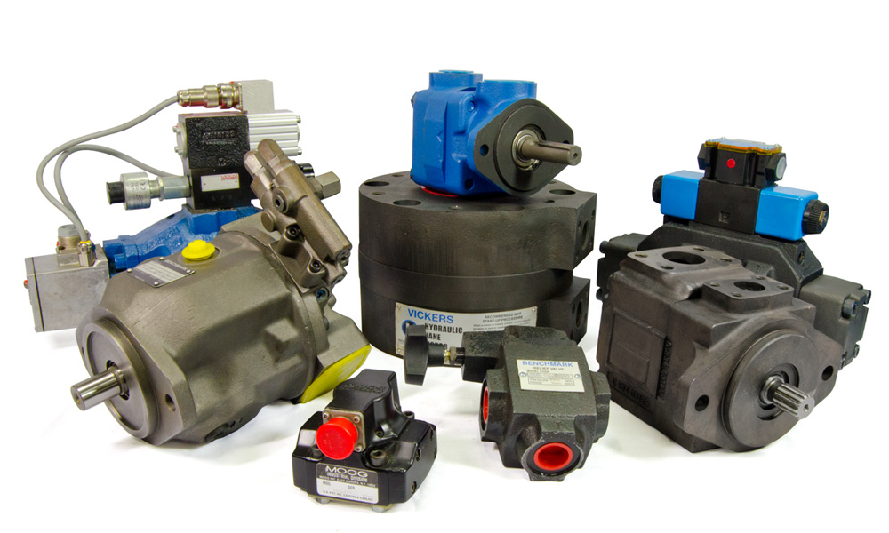 Remanufactured hydraulic piston pumps and vane pumps & motors, servo and proportional valves laid out on white background.